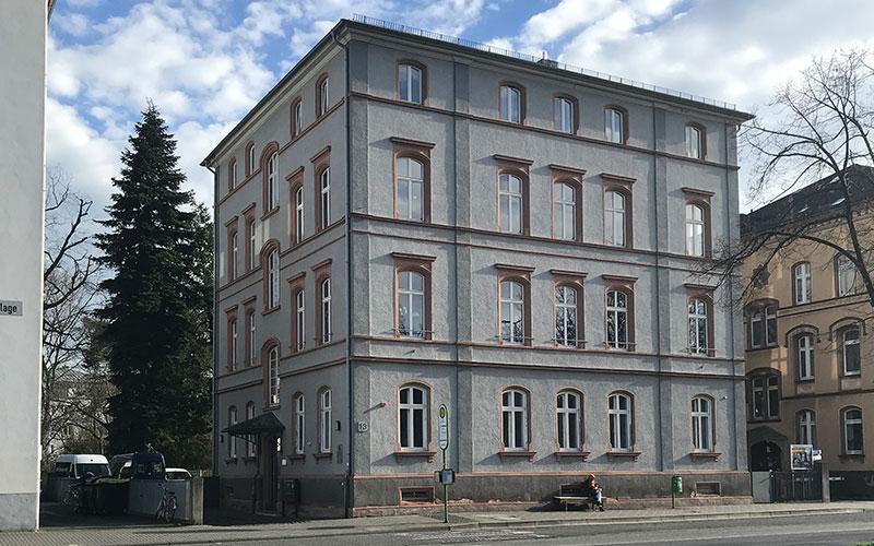 Sanierung denkmalgeschützte Fenster eines Mehrfamilienhauses